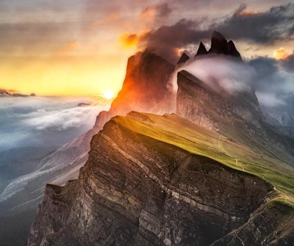 The sun breaks through at Seceda in the Italian Dolomites | Photography by ©Andreas Wonisch