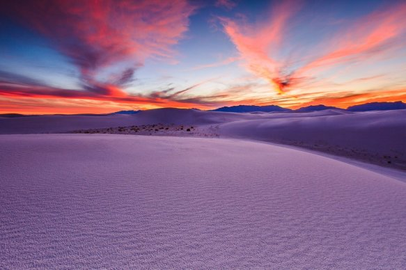 sunset-casts-incredible-colors-on-an-ocean-of-sand-dunes-at-white-sands-nps-newmexico-photography-by-hongxun-gao