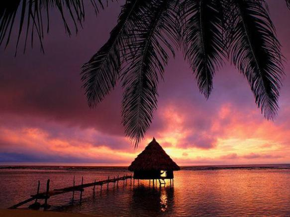 an-overwater-palapa-provides-an-idyllic-spot-to-watch-a-sunrise-in-belize-photography-by-mark-lewis