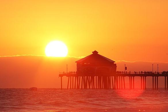sun-lighting-up-the-huntington-beach-pier-in-california-photography-by-nate2b