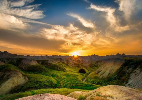 Sunset illuminates the rugged landscape at Badlands National Park, South Dakota | Photography by ©William Green